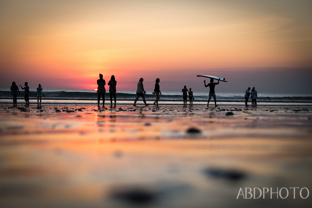surfers kuta beach bali indonesia at sunset