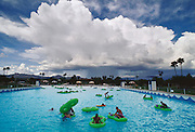 Weather: A thunderhead cloud approaches the Breakers Water Park in Tucson, Arizona. A lightning detector is used to monitor the proximity of lightning, giving the lifeguards time to warn the swimmers when to get out of the water. (1993)