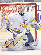 Lake Superiior State University goaltender Brian Mahoney-Wilson watches a rebounding blocked shot go airborne during the third period of the Lakers Saturday night game against the Canisius Griffins.
