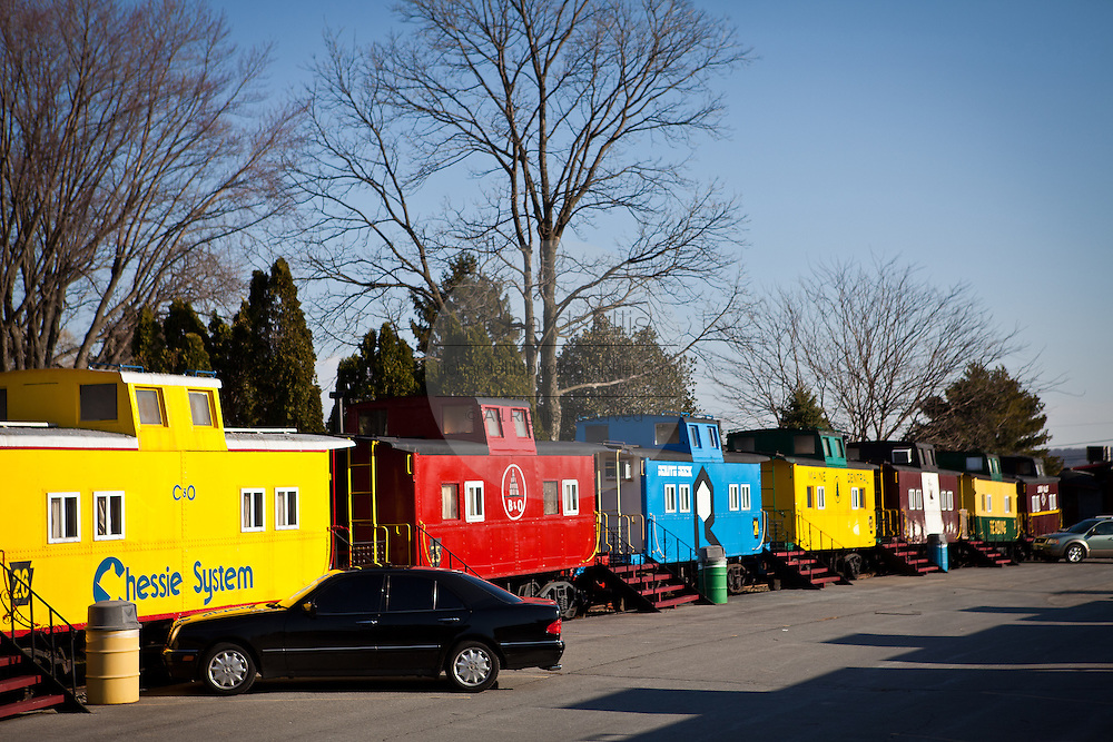 Line of retired caboose cars converted into hotel rooms at the Red Caboose Motel in Strasburg, PA.