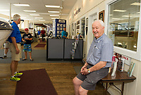 Jack Irwin in the showroom of Irwin Marine.  (Karen Bobotas for New England Boating Magazine)