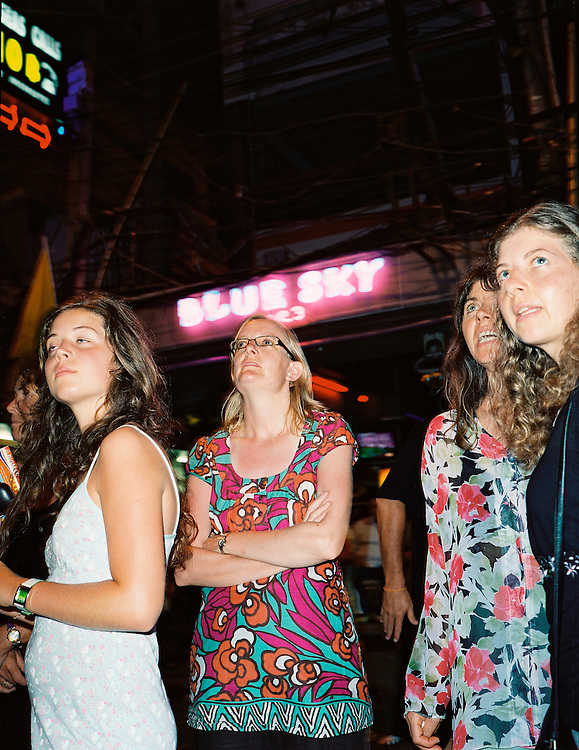 English tourists gape at the night life on Walking Street.