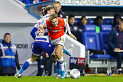 Reading midfielder John Swift (10) tussles with Luton Town forward Harry Cornick (14) during the EFL Sky Bet Championship match between Reading and Luton Town at the Madejski Stadium, Reading, England on 9 November 2019.