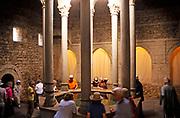 Tourists inside the historic Arab baths building, Girona, Catalonia, Spain