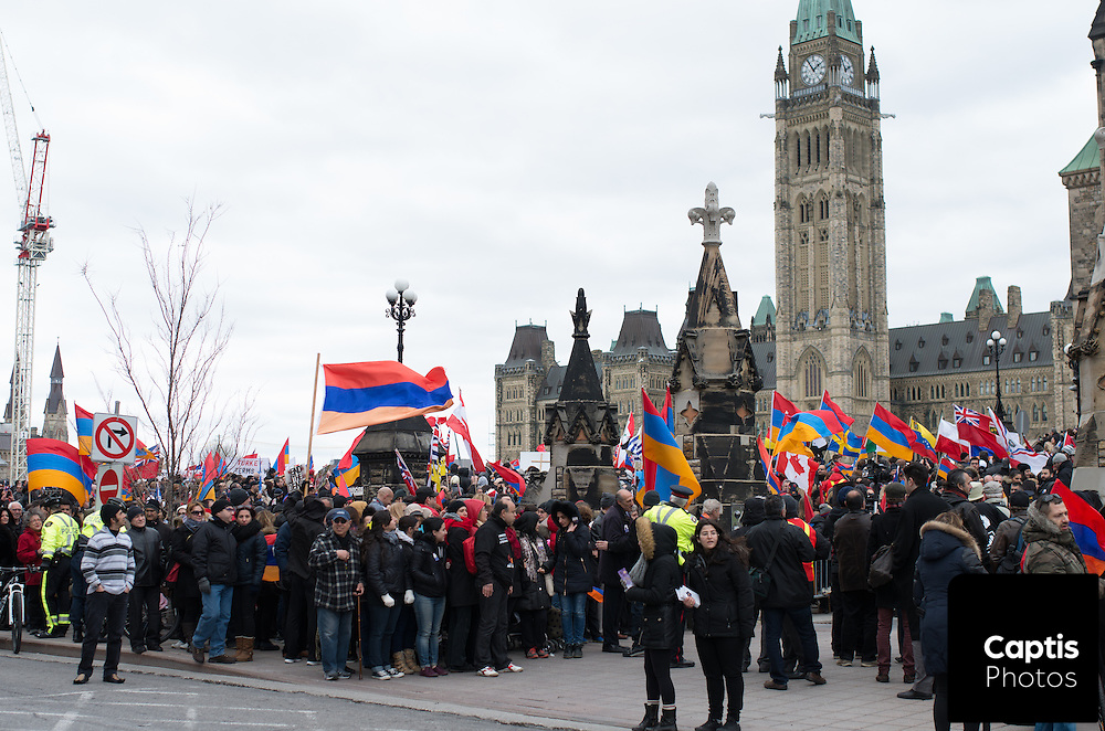 Thousands of Armenians and supporters marched from Parliament Hill to the Turkish embassy in Ottawa to mark the 100th anniversary of the Armenian genocide. The march was met by a Turkish counter-protest in MacDonald Gardens park, outside the embassy. The two groups were separated by temporary fences and a heavy police presence. Both sides exchanged words and gestures, but the demonstration remained peaceful. April 24, 2015<br />