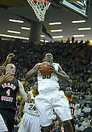 December 04 2010: Iowa Hawkeyes forward Devon Archie (35) drives to the basket during the first half of their NCAA basketball game at Carver-Hawkeye Arena in Iowa City, Iowa on December 4, 2010. Iowa won 70-53.