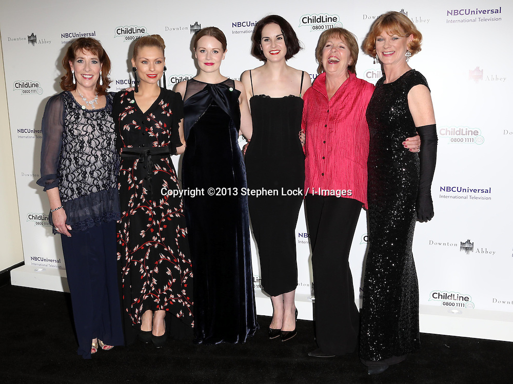 Downton Abbey actress's from left; Phyllis Logan, MyAnna Buring, Cara Theobold, Michelle Dockery, Penelope Wilton and Samantha Bond  arriving at the Downton Abbey ChildLine Ball in London, Thursday, 24th October 2013. Picture by Stephen Lock / i-Images