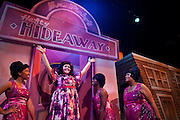 "Lindsey Hedberg, playing the role of Tracy Lindblad, raises her arms proudly during the Coeur d'Alene Summer Theatre's production of ""Hairspray."" Hedberg is flanked by the three members of The Dynamites, left to right, Yudith Burton, Oyoyo Joi Bonner and Antonia Darlene.The show will premiere at North Idaho College's Boswell Hall Schuler Performing Arts Center at 7:30pm on August 7th."