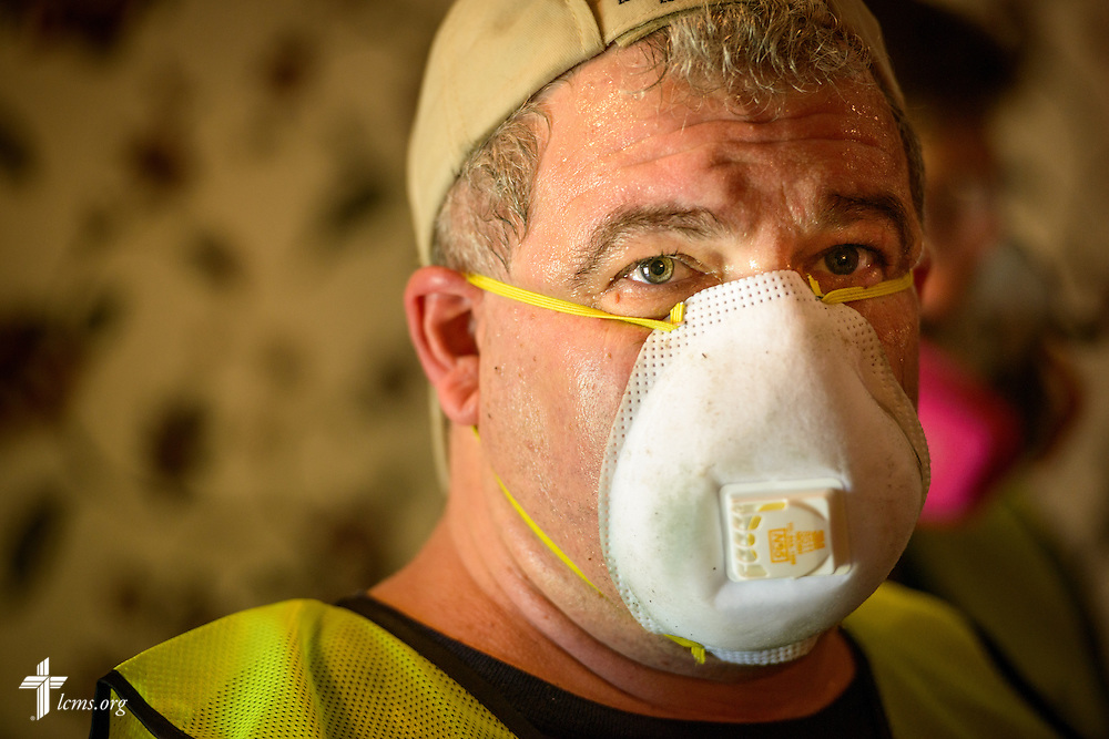 Volunteer Don Teijelo of New Orleans helps with muck-out efforts in a flood-damaged home on Wednesday, Sept. 14, 2016, in Baton Rouge, La.  LCMS Communications/Erik M. Lunsford