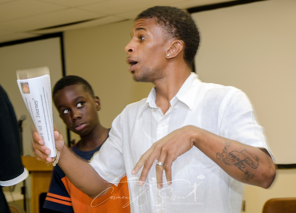 Marquise Lowe, site director and program coordinator for the Young People's Project, leads students through an exercise Aug. 3, 2013, in Jackson, Miss. The nonprofit organization was founded in 1996 and focuses on math literacy as a way to empower youth and help them overcome obstacles to their success. (Photo by Carmen K. Sisson/Cloudybright)