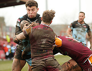 Dave Scott of Batley Bulldogs tackles Jack Owens of Leigh Centurions during the Ladbrokes Challenge Cup match at Fox's Biscuits Stadium, Batley<br /> Picture by Stephen Gaunt/Focus Images Ltd +447904 833202