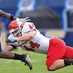 Oct 25, 2008; Pittsburgh, PA, USA; Rutgers linebacker Ryan D'Imperio (44) stretches out to trip up Pittsburgh running back LeSean McCoy during the third quarter of Rutgers 54-34 victory at Heinz Field.