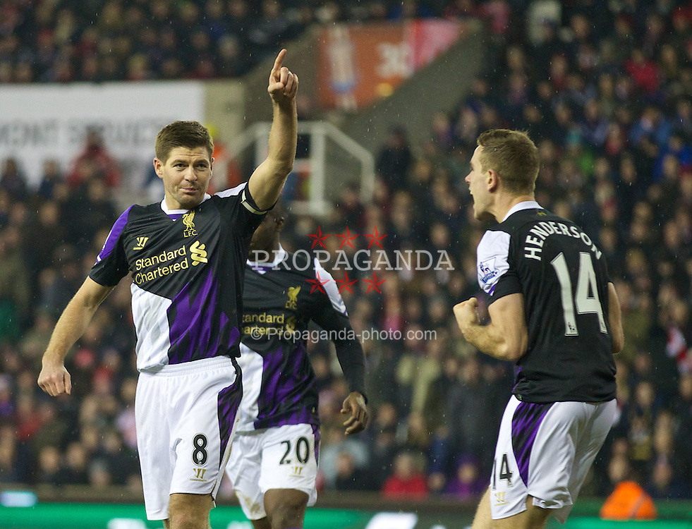 STOKE-ON-TRENT, ENGLAND - Sunday, January 12, 2014: Liverpool's captain Steven Gerrard celebrates scoring the third goal against Stoke City from the penalty spot during the Premiership match at the Britannia Stadium. (Pic by David Rawcliffe/Propaganda)