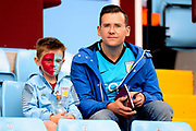 A young  face painted Villa fan and his dad wait for kick off during the EFL Sky Bet Championship match between Aston Villa and Norwich City at Villa Park, Birmingham, England on 19 August 2017. Photo by Dennis Goodwin.