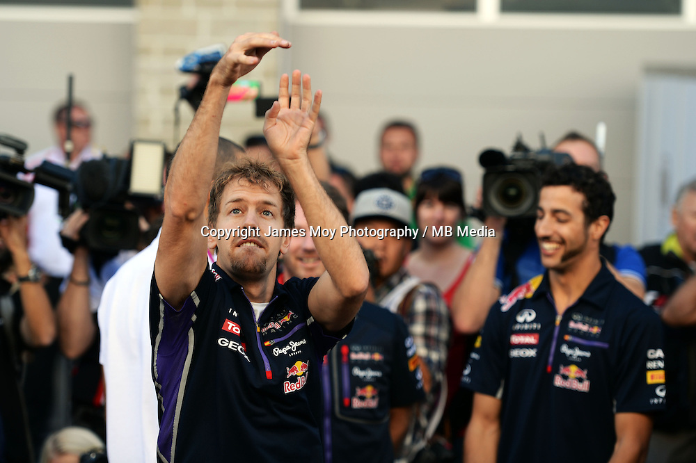 (L to R): Sebastian Vettel (GER) Red Bull Racing practices his basketball skills with Daniel Ricciardo (AUS) Red Bull Racing (Right).<br /> United States Grand Prix, Saturday 1st November 2014. Circuit of the Americas, Austin, Texas, USA.