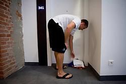 Matjaz Vezjak preparing jerseys and towels for Jurica Golemac (14) of Slovenia in a Andel's Hotel during Eurobasket 2009, on September 15, 2009 in  Lodz, Poland.  (Photo by Vid Ponikvar / Sportida)