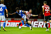 City's Midfielder Jacques Maghoma and  Brentford's Midfielder Alan Judge during the EFL Sky Bet Championship match between Brentford and Birmingham City at Griffin Park, London, England on 2 October 2018.
