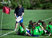 Coaching youth girls soccer game.