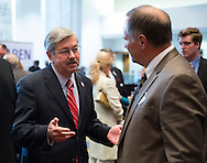 DES MOINES, IA - OCTOBER 25, 2013: Iowa Republican Governor Terry Branstad talks with someone at the Iowa GOP Ronald Reagan Dinner at the Iowa Events Center - Community Choice Credit Union Convention Center in Des Moines, Iowa.