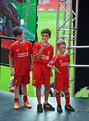 LIVERPOOL, ENGLAND - Friday, April 10, 2015: Liverpool supporters on stage during the launch for the New Balance 2015/16 home kit at Anfield. (Pic by David Rawcliffe/Propaganda)