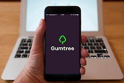 Using iPhone smartphone to display logo of Gumtree, website for classified advertising