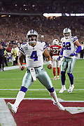 Dallas Cowboys quarterback Dak Prescott (4) yells out and celebrates after running for a second quarter touchdown that ties the score at 7-7during the 2017 NFL week 3 regular season football game against the against the Arizona Cardinals, Monday, Sept. 25, 2017 in Glendale, Ariz. (©Paul Anthony Spinelli)