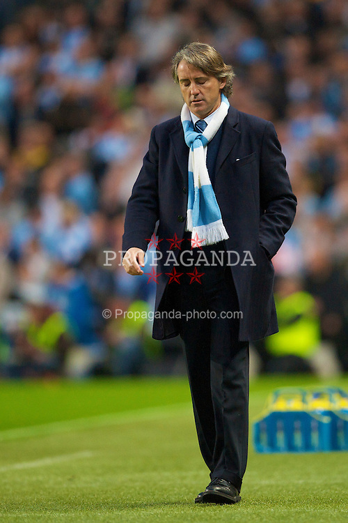 MANCHESTER, ENGLAND - Wednesday, May 5, 2010: Manchester City's manager Roberto Mancini looks dejected during the Premiership match against Tottenham Hotspur] at City of Manchester Stadium. (Photo by David Rawcliffe/Propaganda)