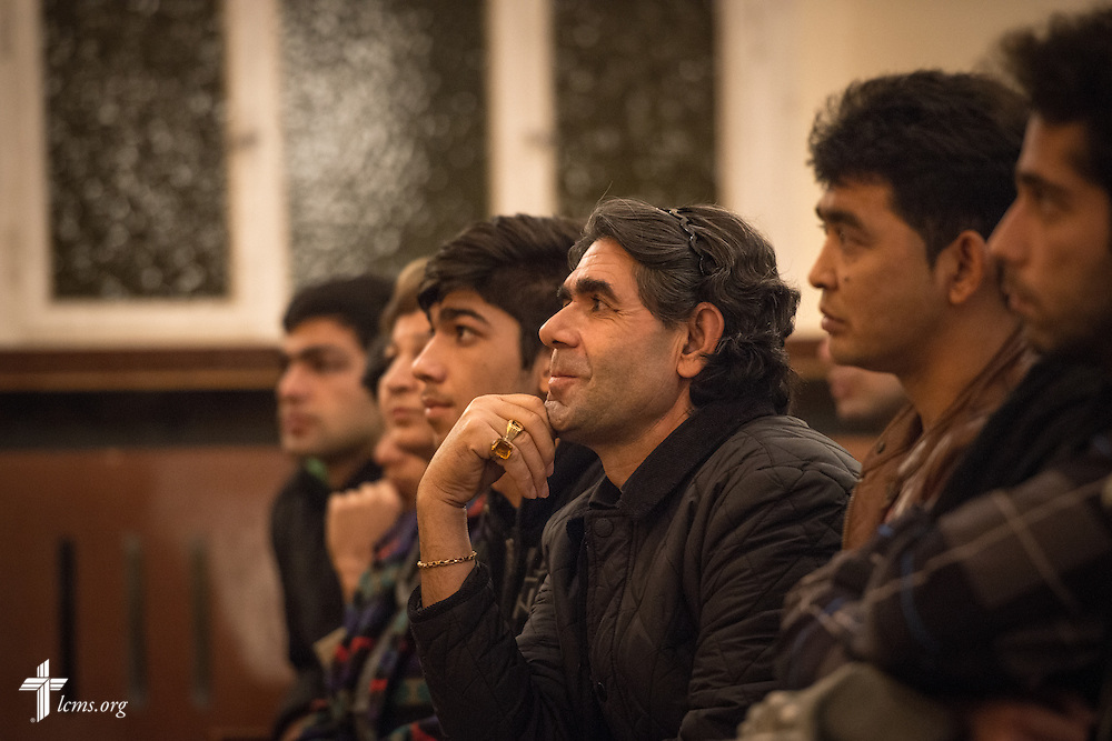 An Afghani man listens as the Rev. Dr. Gottfried Martens instructs them during baptism rehearsal on Saturday, Nov. 14, 2015, at the Dreieinigkeits-Gemeinde, a SELK Lutheran church in Berlin-Steglitz, Germany.   LCMS Communications/Erik M. Lunsford