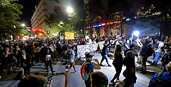 September 23, 2016 - Charlotte, NC, USA - Protesters march through the streets of Charlotte, N.C., on Friday, Sept. 23, 2016, as demonstrations continue following the shooting death of Keith Scott by police earlier in the week. (Credit Image: © Jeff Siner/TNS via ZUMA Wire)