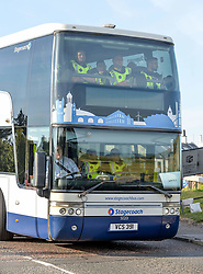 Pictured: Extra police arrive on a double decker bus.<br /> <br /> Protesters gathered amid tight security at the Trump Turnberry resort, where President Trump and his wife Melania are staying on their trip to Scotland.<br /> <br /> &copy; Dave Johnston / EEm