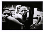 Lowest of the low: Tenacious young boys begging at traffic signal while cars must wait for the signal to change.  Most intersections on most main traffic arteries are staked out by children, young mothers, or the handicapped< Mumbai, India.