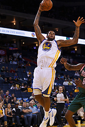 Mar 16, 2012; Oakland, CA, USA; Golden State Warriors forward Jeremy Tyler (3) shoots against the Milwaukee Bucks during the fourth quarter at Oracle Arena. Milwaukee defeated Golden State 120-98. Mandatory Credit: Jason O. Watson-US PRESSWIRE
