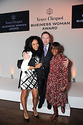 Left to right, KANYA KING founder of the MOBO Awards, JONATHAN SHALIT and ? at the presentation of the Veuve Clicquot Business Woman Award 2010 held at the Institute of Contemporary Arts, 12 Carlton House Terrace, London on 23rd March 2010.  The winner was Laura Tenison - Founder and Managing Director of JoJo Maman Bebe.