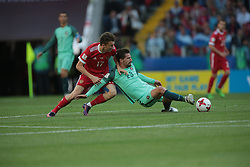 June 21, 2017 - Moscow, Russia - Alexander Golovin (L) of the Russian national football team and Adrien Silva of the Portugal national football team vie for the ball during the 2017 FIFA Confederations Cup match, first stage - Group A between Russia and Portugal at Spartak Stadium on June 21, 2017 in Moscow, Russia. (Credit Image: © Igor Russak/NurPhoto via ZUMA Press)