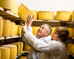 Scottish Lib Dem leader Willie Rennie gets to grips with one of the cheeses along with local candidate Elizabeth Richef when he visited St Andrews Farmhouse Cheese Company in Pitenweem in Fife in the run up to the 2017 General Election.<br /> <br /> © Dave Johnston/ EEm