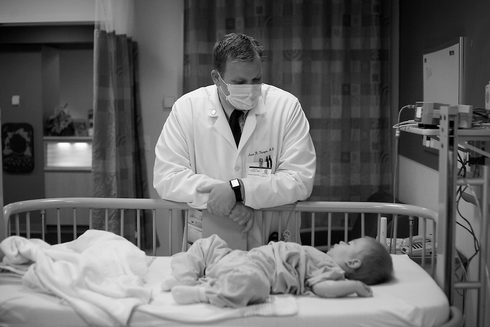 Aaron Traegar, a doctor at St. Louis Children's Hospital, evaluates Kade's breathing after being admitted for respiratory distress.  Kade has spent many nights in the unit in his short two years.