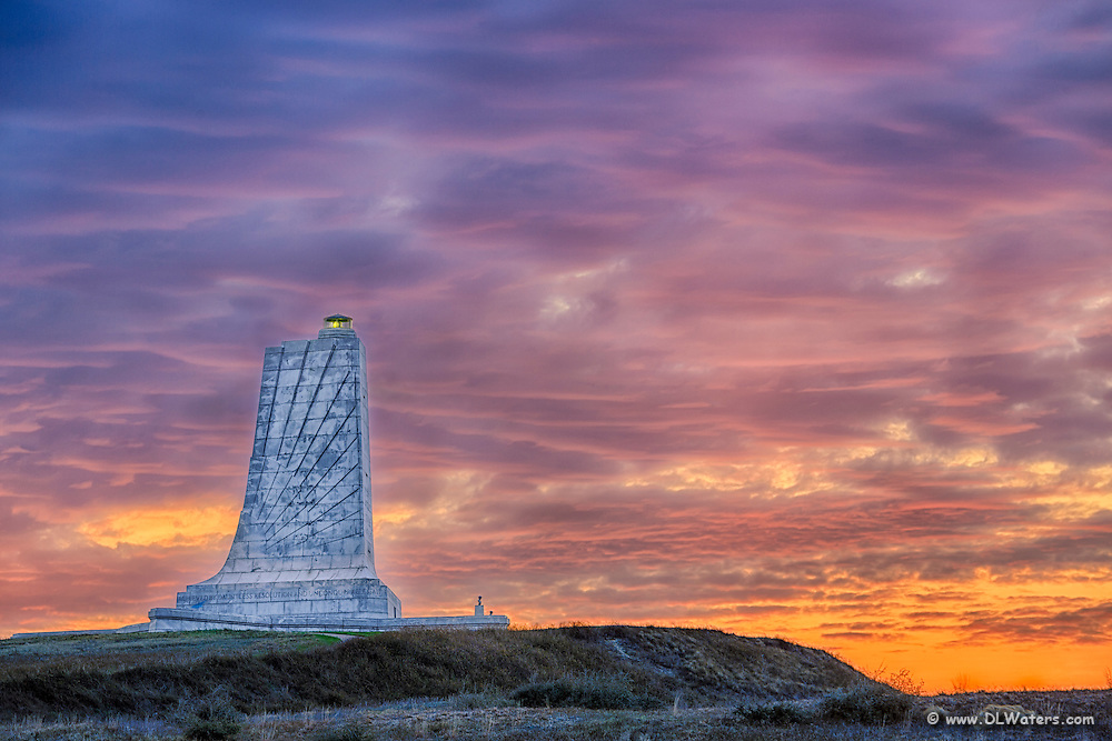 Colorful sunrise over the Wright Brothers Memorial in Kill Devil Hills on the Outer Banks.