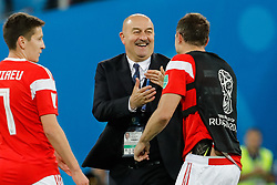 June 19, 2018 - Saint Petersburg, Russia - Russia national team head coach Stanislav Cherchesov (C) and Artem Dzyuba (R) of Russia national team celebrate victory during the 2018 FIFA World Cup Russia group A match between Russia and Egypt on June 19, 2018 at Saint Petersburg Stadium in Saint Petersburg, Russia. (Credit Image: © Mike Kireev/NurPhoto via ZUMA Press)