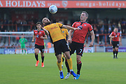 Dan Butler of Newport County shields the ball from Garry Thompson of Morecambe during the EFL Sky Bet League 2 match between Morecambe and Newport County at the Globe Arena, Morecambe, England on 16 September 2017. Photo by Mick Haynes.