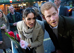 Prince Harry and his fiancee Meghan Markle speak with well wishers as they leave Reprezent 107.3FM radio station in Brixton, London. Picture dated: Tuesday January 9, 2018. Photo credit should read: Isabel Infantes / EMPICS Entertainment.