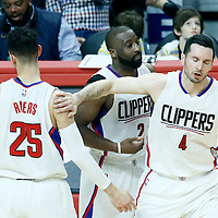 16 January 2017: LA Clippers guard J.J. Redick (4) is congratulated by LA Clippers guard Austin Rivers (25) and LA Clippers guard Raymond Felton (2) during the LA Clippers 120-98 victory over the Orlando Magic, at the Staples Center, Los Angeles, California, USA.