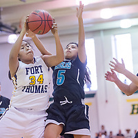 Piñon Eagle Shandiin Nelson (5) loses a rebound to Fort Thomas Apache Lacey Gaseynn (34) Saturday at Yavapai Community College in Prescott, Ariz.