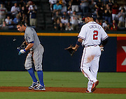 ATLANTA - AUGUST 13:  Outfielder Scott Podsednik #21 of the Los Angeles Dodgers reacts after being tagged out by shortstop Alex Gonzalez #2 of the Atlanta Braves during the game at Turner Field on August 13, 2010 in Atlanta, Georgia.  The Braves beat the Dodgers 1-0.  (Photo by Mike Zarrilli/Getty Images)
