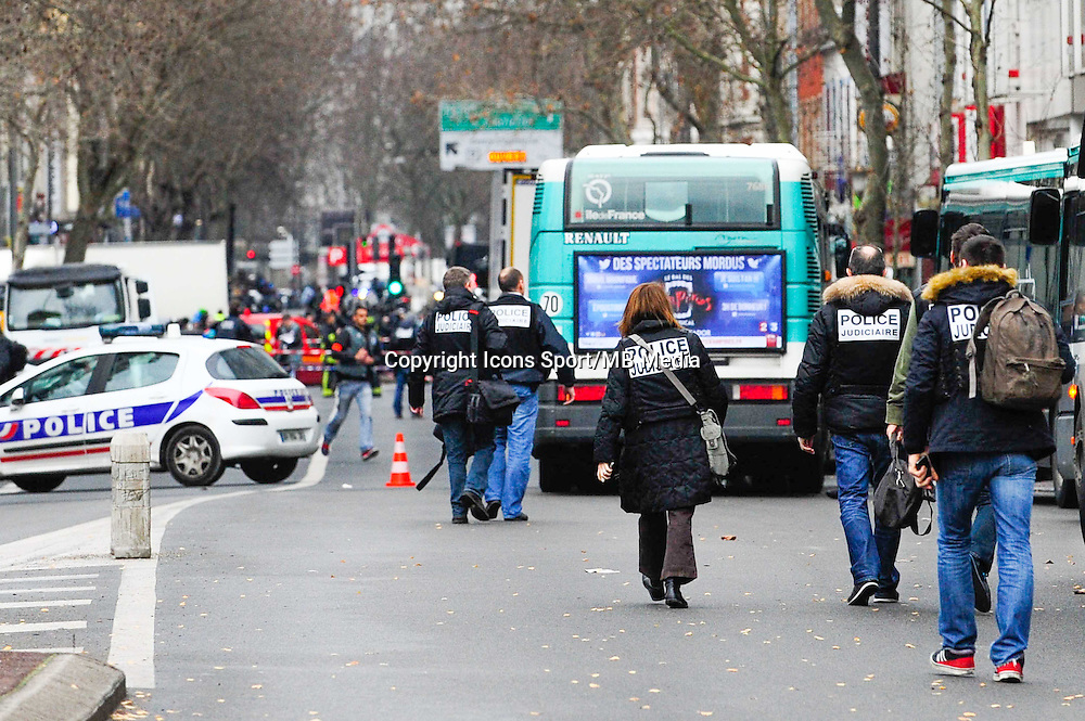Fusillade Montrouge - 08.01.2015 - Rue de la fusillade / Interpellation Hotel Atlantide  <br /> Photo : Dave Winter / Icon Sport<br /> <br /> At around 07:50 (local time), following a car accident involving grey Renault Clio in the town of Montrouge, a suburb of Paris, a shoot-out ensued during which a police officer and one other person were shot. A 52 year-old man was arrested at the scene, whilst a second escaped, later abandoning his vehicle in the town of Arcueil. At 10:50 it was announced that the police officer, a woman, had died of her injuries whilst a 47 year-old man was still in critical condition. It's still not clear whether there's any link between this shooting and the deadly attack at the office of the Charlie Hebdo magazine the previous day. At approximately 11:30, the BRI (Brigade de recherch&Atilde;&copy; et d'intervention- the French equivalent of a SWAT team) secured the Hotel Atlantide on avenue Pierre Brossolette, a hundred or so metres from the scene of the car accident and shooting. A handcuffed man in a red hoodie was seen being led into the hotel, before being lead away some twenty minutes later.