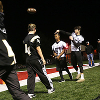 Lauren Wood | Buy at photos.djournal.com<br /> Amory's Aaron Stringfield throws the ball on the sidelines before the start of Friday night's game at Corinth.