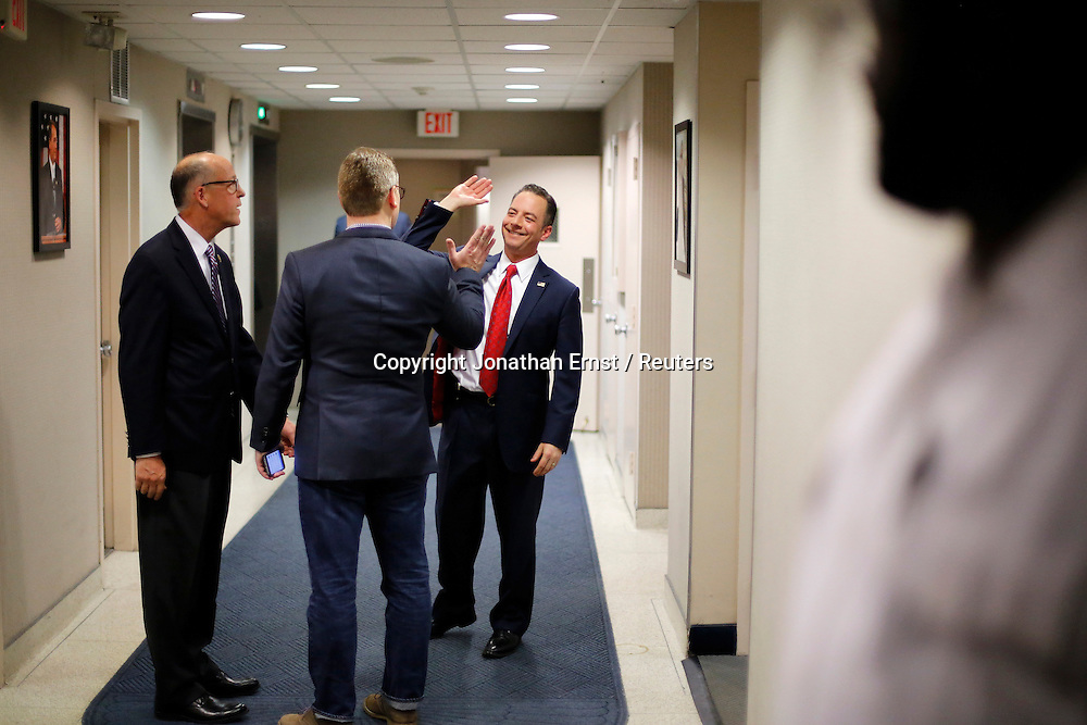 As one victory after another went to Republican candidates on election night to give control of the both houses of Congress to the GOP, Republican National Committee Chairman Reince Priebus shares high-fives with associates in the hallway after a news conference at RNC headquarters on Capitol Hill in Washington.