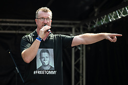 "© Licensed to London News Pictures. 14/07/2018. London, UK. KEVIN CARROLL . Supporters of EDL founder Tommy Robinson ( real name Stephen Yaxley-Lennon ) and US President Donald Trump hold a "" Welcome Trump "" rally on Whitehall . Trump is currently in Scotland and Robinson is in HMP Hull . Photo credit: Joel Goodman/LNP"