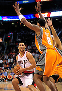 Mar. 21 2010; Phoenix, AZ, USA; Portland Trailblazers guard Brandon Roy (7) is guarded by Phoenix Suns center Channing Frye (8) in the first half at the US Airways Center.   Mandatory Credit: Jennifer Stewart-US PRESSWIRE.