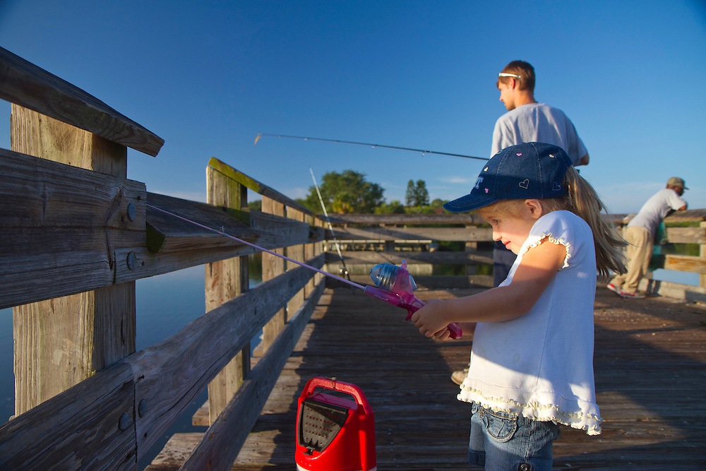 Robert Adams and his four-year-old daughter Alexandrea Adams fish from the fishing pier at Weedon Island Preserve. Nestled between the thriving cities of Tampa and St. Petersburg, Weedon Island Preserve offers a fun and easy daytrip for fishing, hiking and paddling. 2 mile and 4 mile paddling trails meander through mangrove tunnels, over seagrass flats and around mangrove islands. The preserve also offers ample wildlife viewing on hiking trails and from an observation tower. .Photo by James Branaman