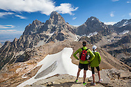 Two hikers stop at the top of Table Mountain, Wyoming, to take in the view of the Grand Teton in Teton National Park. http://www.gettyimages.com/detail/photo/hikers-taking-in-view-of-grand-tetons-wy-high-res-stock-photography/516032909